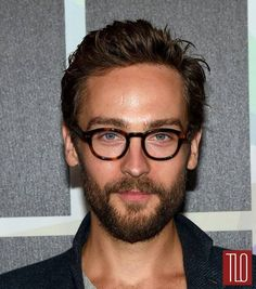 He knows how to wear glasses with style!