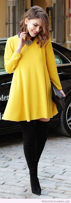 Yellow sleeve dress with black tights & high black boots