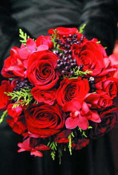 Bouquet of roses, orchids, berries, and greenery    Floral design by Winston Flowers