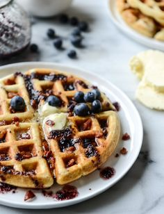 crispy bacon waffles with bourbon butter + blueberry syrup