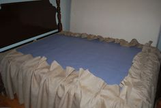 DIY burlap dust ruffle. This would look awesome with our bed!