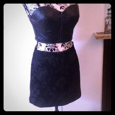 """Black brocade mini NWT!! Express black brocade mini skirt. Cotton/acetate blend skirt is lined & has a  side zipper. 13 1/2"""" waist laying flat, 14.5"""" length. Top also listed separately in my closet. REASONABLE OFFERS ACCEPTED!!😀 Express Skirts Mini"""