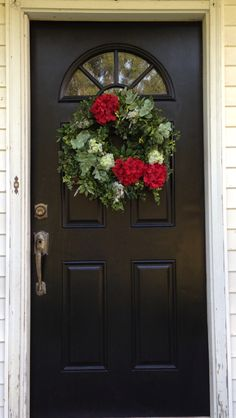 Fresh coat of black paint, and made a new wreath to stand out on the black door!!!