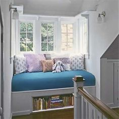 what a cozy spot! I'd probably put a drawer underneath to store linens or tissue boxes or something equally as mundane.