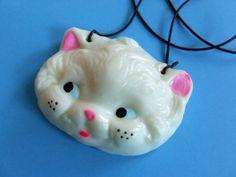 // glow in the dark cat necklace