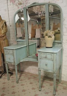 this could work; I like the roomy drawers, the cutaway for a stool, tri-fold mirror