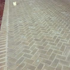 Herringbone patio at one of my current jobs. Love the gray brick:
