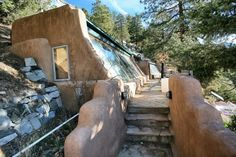 Earthship biotecture - A great view showing the facade and front entry walk