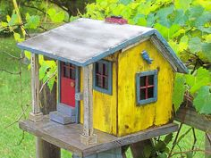 glass bird feeder Love this little shed-style bird house Hosta and Bird House Hummingbird Fairy house