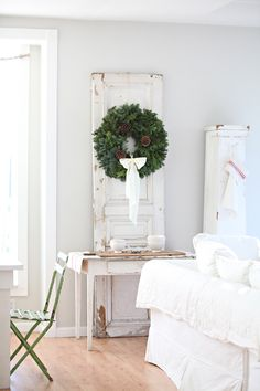 dark green wreath against the vintage white door