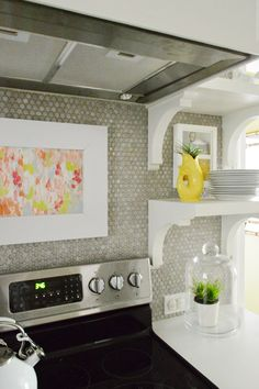 Love the backsplash, the Art, and the shelves!  Why would I NEVER think to hang art or mount cute white shelves on a tile backsplash?!