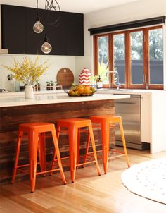 Love the wood accents, the lights, the window, orange chairs