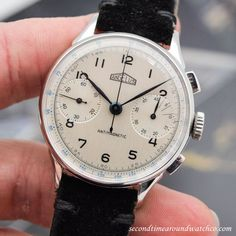 Fantastic! A 1950's era Angelus Chronograph with a chrome and stainless steel case, a silver dial with black-colored, Arabic numerals, two subregisters, and a 17-jewel, manual-wind, caliber 215 movement. At 36mm, this timepiece wears well on the... #angelus #steel #chronograph #antimagnetic #chrono #vintage #watch #classic #timepieces #wristwatch #cool #watches #stawc #wristwatches