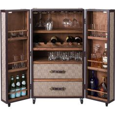 "Dorris Home Bar. Entertain like a pro with this convenient home bar, featuring a castered design and ample interior storage. Engineered wood, iron, leather, canvas. Brown & natural. •4 castered wheels •2 doors •3 shelves on each door •Removable wheels •Two drawers • Hand-painted •Cabinet Basin: 24.4"" H x 23.6"" W x 11.8"" D •Drawer: 6"" H x 21.25"" W x 10.5"" D •Overall: 42.13"" H x 23.62"" W x 17.72"" D"