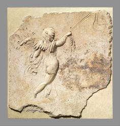 Stucco relief panel. Period: Early Imperial, Neronian. Date: mid-1st century A.D. Culture: Roman. Eros, walking to the right, holds a cornucopia in his left hand and a long staff or wand in his right.
