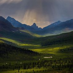 Mother Nature shines her light on the Tombstone Mountains in the Yukon Territories, Canada. --------- As we made our way down the Dempster Highway we entered the Tombstone Mountains. The weather was less than ideal but we got lucky at this lookout as the sun dappled the valley and created a beautiful scene. -------- Sony A7RII Zeiss 16-35 F4 F/11 15 seconds. -------- #travelyukon #explorecanada