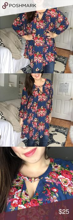 Floral tunic Floaty tunic that can we worn as a short dress or with jeans as a top. Beautiful material that flows when walking (SO PRETTY). Like new and top button closure has been replaced. Base color is light navy blue. Tops Tunics