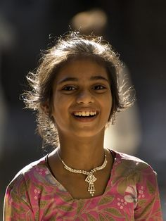 Photographer Name : Murali Krishna Kanakatla Description : This candid pic got into my camera in the streets of varanasi on ramzanday, 2011. Had seen this beautiful girl with a beautiful smile on her faces with backlighting on her hair which made this pic more interesting to click