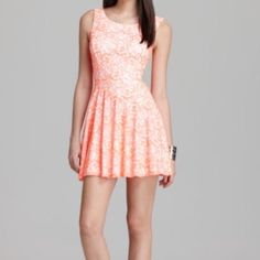 NWT afterglow guess fit and flare summer dress M NWT afterglow guess fit and flare summer dress M- never worn, cut out in back. Perfect for summer.   No longer available anywhere. Color is a really unique bright coral lace over white. Could be worn to a wedding or graduation :) Reasonable offers welcome. Guess Dresses Mini