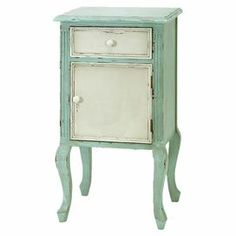 """A cottage-chic addition to your sofa or arm chair, this wood end table features cabriole legs, and a distressed white and green finish.   Product: End tableConstruction Material: WoodColor: Distressed white and greenFeatures: One drawers and one doorDimensions: 35"""" H x 18"""" W x 14"""" D"""