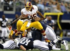 Alfred Morris fights for yardage against Dallas.