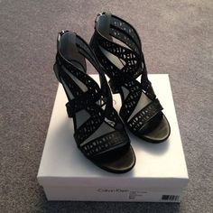 HP 8/24 NIB Gorgeous Calvin Klein Heels Brand new, never worn Calvin Klein black heels. Only tried on in store before purchasing. Beautiful cut out design on leather. Back zipper. Comfortable thanks to lots of strap and back heel support. Total statement shoes! Calvin Klein Shoes Heels