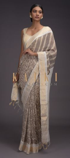 Rhino grey saree in tussar silk with batik print in floral jaal pattern. It comes with a white border and pallu with zari weaved design. Grey Saree, Plain Saree, Batik Prints, Printed Sarees, Indian Wear, Silk Sarees, Tassels, Ethnic, Designers