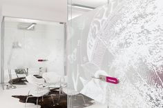 By printing this fabulous design onto frosted film using white ink, it was possible to achieve a striking, eye-catching result. The frosted film provides privacy, whilst the vivid design really brings the room to life.  www.windowfilm.co.uk