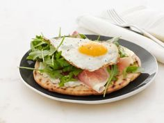 Crispy Breakfast Pita: Giada De Laurentiis makes a pizza-style breakfast using pita bread topped with cheese, prosciutto, spinach and a fried egg.
