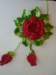 This chain loop flower is a cute and simple crochet flower. It's made of chains and double crochet stitches. It's a nice puffy flower that works great as a decoration on a hat, scarf, shawl, bag and more. Crochet Flower Tutorial, Crochet Flower Patterns, Crochet Motif, Crochet Doilies, Crochet Yarn, Crochet Flowers, Crochet Hooks, Crochet Crafts, Crochet Projects