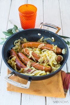 Mustard sausage and onions in a skillet