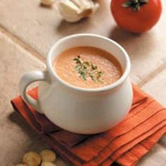 """Garlic Tomato Soup Recipe -Roasted garlic adds a mellow background flavor to this rich, creamy tomato soup from Marilyn Coomer of Louisville, Kentucky. """"Canned tomatoes and puree make it a year-round favorite,"""" she adds. Garlic Soup, Roasted Garlic, Skinny Recipes, Healthy Recipes, Posh Nosh, Creamy Tomato Basil Soup, Tomato Soup Recipes, Food Wishes, Vegetable Puree"""
