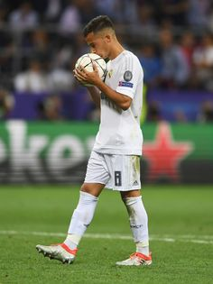 Lucas Vazquez of Real Madrid kisses the ball before the penalty shoot out at the UEFA Champions League Final match between Real Madrid and Club Atletico de Madrid at Stadio Giuseppe Meazza on May 28, 2016 in Milan, Italy. (May 27, 2016 - Source: Laurence Griffiths/Getty Images Europe)
