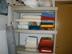 Batting and lots of mixed fabrics. Bolt of red felt, I have some plans for this that include head to toe. There is lots of flannel, below the bottom shelf are two large storage bins, one filled with flannel and fleese, the other blue jean pieces. This will look better when I make a curtain for it and close it off.