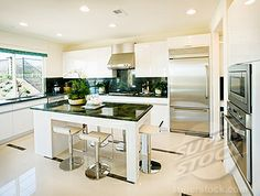 Stock Photo #4053-2518, Modern white kitchen with green granite countertops