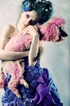 Russian Model Inga Krasiva with her poodle  The clothes and Hair of someone from a fairy tale--or from the Hunger Games' Capitol.