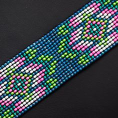 These beaded bracelets were designed and hand-loomed by crafter Charlotte Disbrowe. Charlotte is Anishinaabe from Winnipeg, Manitoba. She is from the Algonquin Ojibwe peoples. Learning from her Mom at a young age, she continues the tradition of loom beading. Inspired by her cultural heritage she designs her artwork on her bead loom using seed beads. This bracelet measures about 13-1/2 long, including the ties, and the beaded band is about 6 long and 1-1/4 wide.