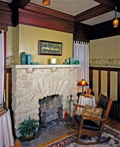 An arched limestone fireplace in another Memphis bungalow features a hearth of Rookwood tiles. The firebox is home to a set of 1930s vintage gas logs. (Photo: Linda Svendsen)
