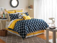 hampton links bed in navy blue with marigold accents by jill rosenwald