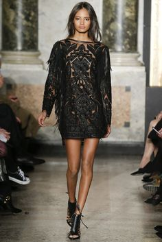 Emilio Pucci Fall - Winter 2014/2015. Dramatic embellished black dress Model: Malaika Firth