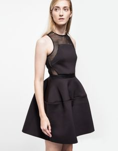 Tulip Dress - From Shakuhachi, a mesh and neoprene dress with modern details. Features a rounded neckline, pinched waist with accented waistband, tulip skirt, netted detailing and back zipper closure.