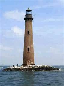 Sand Island Lighthouse is located south of the entrance to Mobile Bay in the Gulf of Mexico.