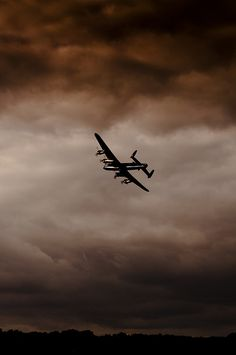 Lancaster bomber by Phil R Ryan The most beautiful of all planes, the sound, the size, the shape. Beauty in the air