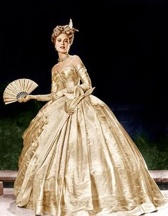 Grace Kelly, photographed wearing the dress Edith Head designed for the masquerade ball of Hitchcock'sTo Catch a Thief (1955)