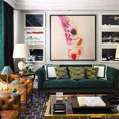 Great looking room. Gallery art, dark floor, nice colored leather