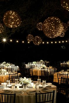 Grapevine balls wrapped with twinkle lights are hung from the trees