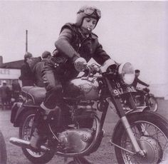 1960s Royal Enfield Cafe Racer Girl.  Very cool.