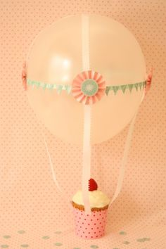 "So cute!  Hot air balloon cupcake! I bet this could be done in an ""UP"" fashion... Alright, who's having an ""UP"" party I can experiment on?"