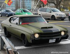 71 chevelle army green black trim 454 with red interior hood scoop. rocker panel vinyl