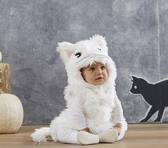 my heart just exploded. a baby in a fluffy white kitten costume.